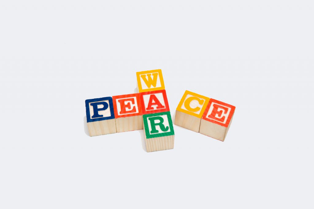 "The words ""War"" and ""Peace"" are spelled out in block letters in a crossword fashion on a white background.  On this image, ""Peace"" is falling apart, possibly signifying that peace talks have fallen apart.  There is plenty of copy space available."