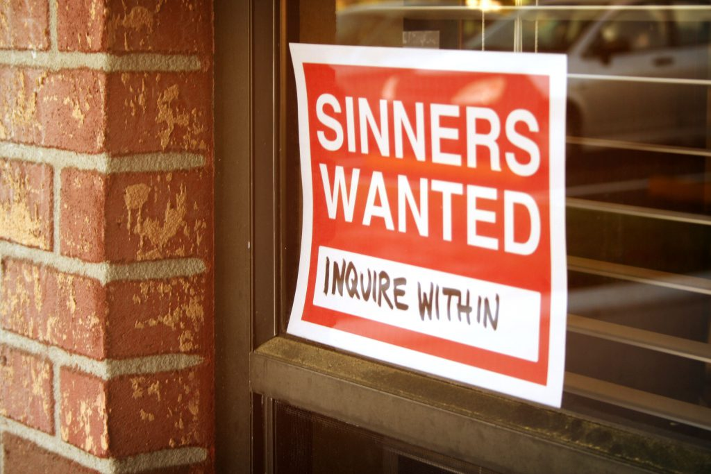 """store window with the sign: """"Sinners wanted, Inquire Within"""""""