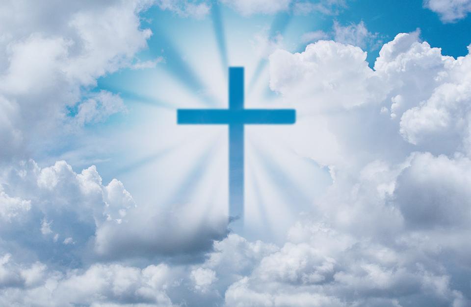 Blue sky, clouds, sun illuminating the cross in the sky