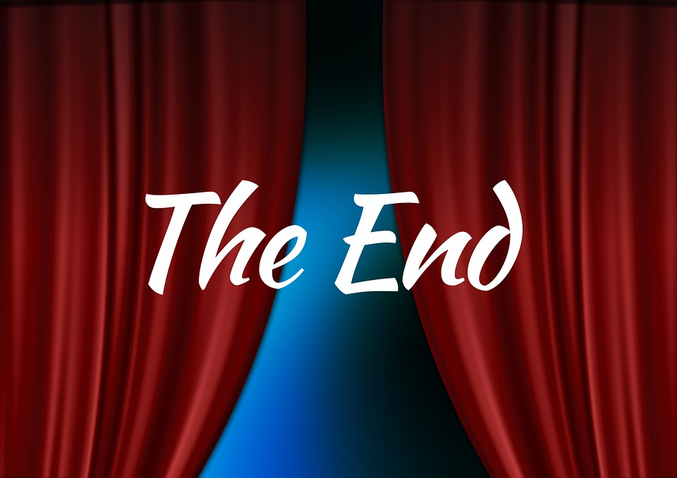 "Stage with curtains and the words ""the end"""