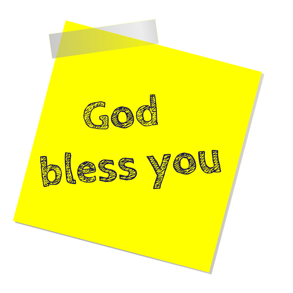 "sticky note with ""God Bless You"" written on it"