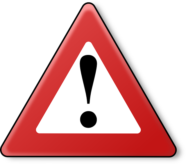 warning sign (black exclamation point inside a red triangle