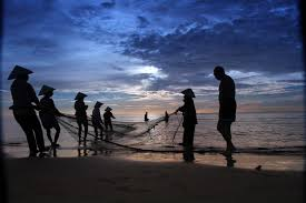 fisherman helping each other with net