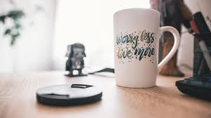 A mug with phrase on it: worry less, live more
