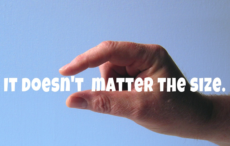 """hand in pinching position, with words """"It Doesn't Matter the Size"""" in between the fingers"""