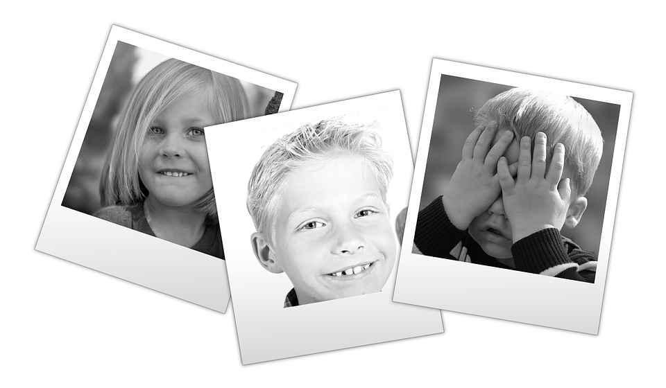 Snapshots of children smiling - the old Poloroid black and white type